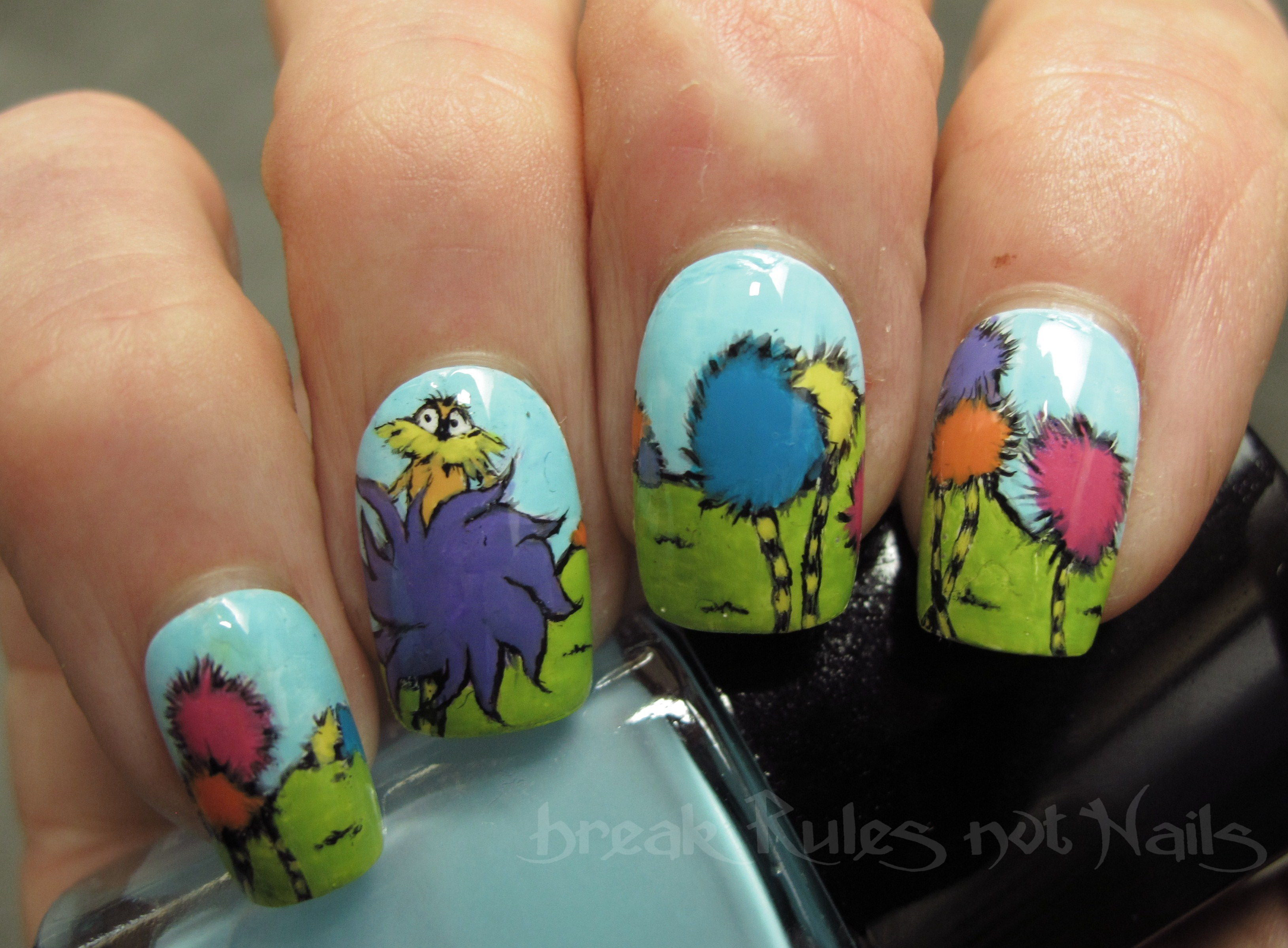 Manicure inspired by the Lorax, probably my favorite Seuss book.